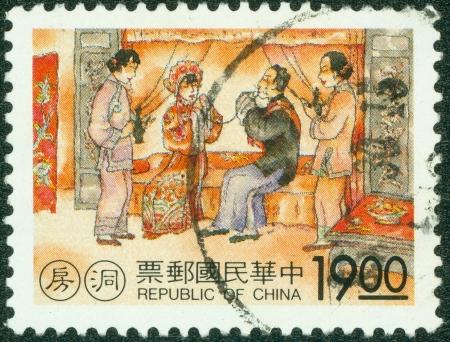 TAIWAN - CIRCA 1990  A stamp printed in Taiwan shows a traditional painting of Bridal chamber, circa 1990 photo