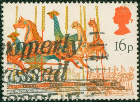 fairs: UNITED KINGDOM - CIRCA 1983  A stamp printed in the UK shows Merry-go-round from British Fairs, series, circa 1983