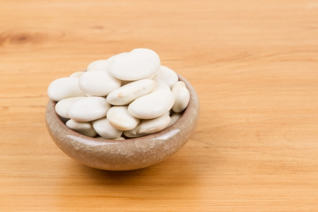 lima beans white beans: large lima beans in bowl on table