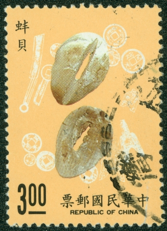 REPUBLIC OF CHINA  TAIWAN  - CIRCA 1976  A stamp printed in the Taiwan shows money cowrie, circa 1976