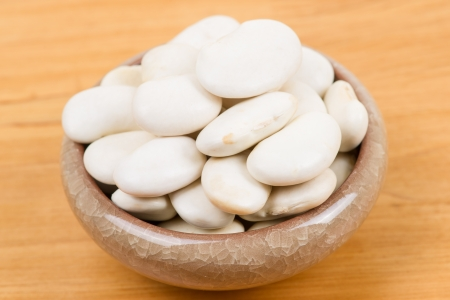 large lima beans in bowl on table photo