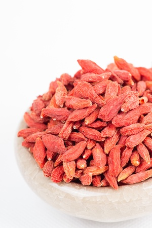 dried wolfberry fruit in bowl on white background Stock Photo - 16933087