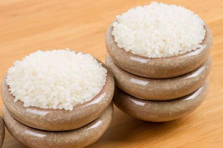 gramineous: White rice in bowl on table Stock Photo