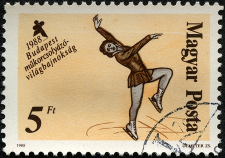 HUNGARY - CIRCA 1988  A stamp printed in HUNGARY shows figure skating, series sport, circa 1988 Stock Photo - 17201787