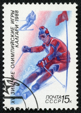 USSR - CIRCA 1988  A stamp printed in the USSR shows skiing, series Olympic Games in Calgary 1988, circa 1988 Stock Photo - 17201796