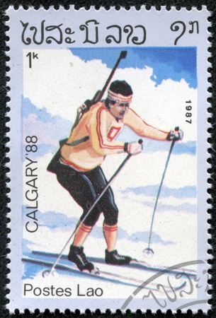 LAOS - CIRCA 1987  stamp printed in Laos, shows Biathlon with the inscription   Calgary 88 , from the series  Winter Olympic Games, Calgary 1988 , circa 1987 Stock Photo - 17201808