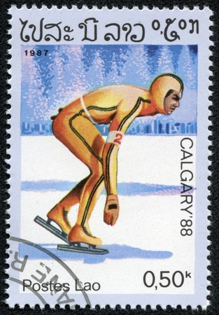 LAOS - CIRCA 1987  stamp printed in Laos, shows Speed Skating with the inscription   Calgary 88 , from the series  Winter Olympic Games, Calgary 1988 , circa 1987 Stock Photo - 17201818