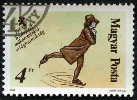 HUNGARY - CIRCA 1988  A stamp printed in HUNGARY shows figure skating, series sport, circa 1988 Stock Photo - 17201788