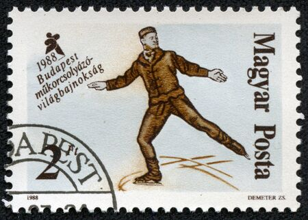 HUNGARY - CIRCA 1988  A stamp printed in HUNGARY shows figure skating, series sport, circa 1988 Stock Photo - 17201791