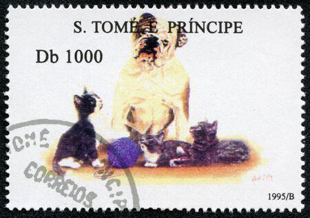 S  TOME E PRINCIPE - CIRCA 1995  A stamp printed in S  Tome e Principe showing dog with cats, circa 1995 photo