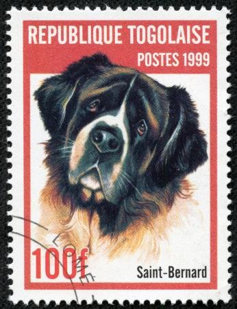 reps: REP�BLICA DE TOGO - CIRCA 1999 sello de correo impreso en Togo muestra un perro, circa 1999 Editorial