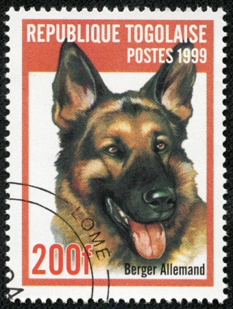 REP OF TOGO - CIRCA 1999  mail stamp printed in Togo shows a dog, circa 1999