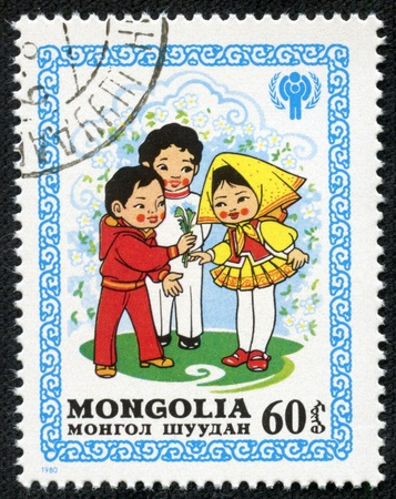 MONGOLIA - CIRCA 1980  stamp printed by Mongolia, shows Boys Presenting Flowers to a Girl, circa 1980 Stock Photo - 17249870