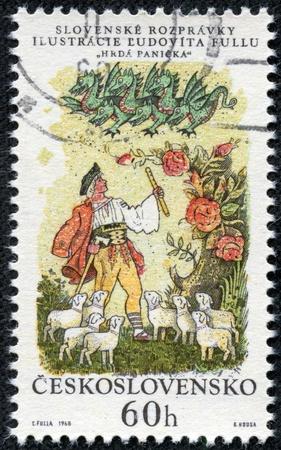 CZECHOSLOVAKIA - CIRCA 1968  A stamp printed in Czechoslovakia, shows a shepherd, sheep and green dragon, circa 1968 Stock Photo - 17249594