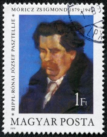 HUNGARY - CIRCA 1979  a stamp from Hungary shows a painting of writer Zsigmond Moricz  1879-1942  by Jozsef Ripple-Ronai, circa 1979 Stock Photo - 17261660