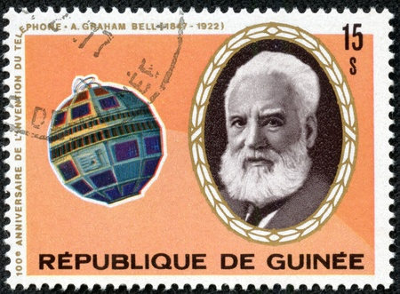 GUINEA - CIRCA 1976  A stamp printed in Guinea shows portrait of Alexander Graham Bell and Telstar satellite, series, circa 1976