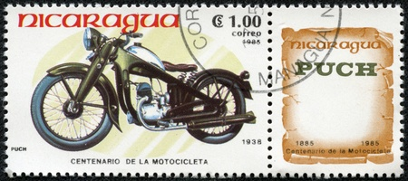 NICARAGUA - CIRCA 1985  A stamp printed in Nicaragua shows image of a vintage motorcycle, Puch 1938, circa 1985 Stock Photo - 17327121