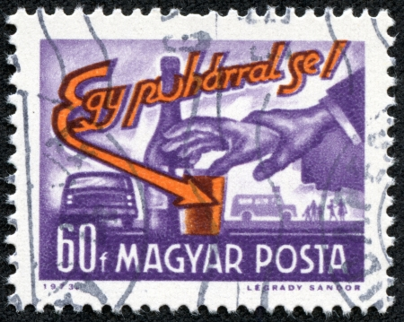 HUNGARY - CIRCA 1973  A stamp printed in the Hungary shows hand, a glass and bottle, inscription Not even one drink, circa 1973