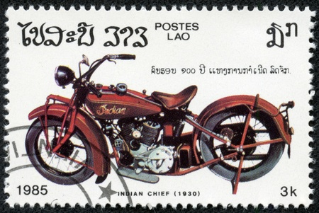LAOS - CIRCA 1985  A stamp printed in Laos shows image a vintage motorcycle, Indian Chief  1930 , circa 1985 報道画像