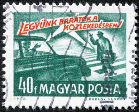 HUNGARY - CIRCA 1973  A stamp printed in Hungary from the  Road Safety  issue shows car and pedestrian and  let s be friends    inscription, circa 1973  Stock Photo - 17327088