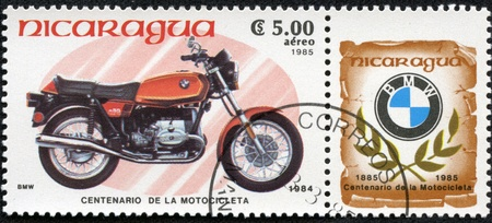 NICARAGUA - CIRCA 1985  A stamp printed in Nicaragua shows image of a vintage motorcycle, BMW 1984, circa 1985 Stock Photo - 17356378