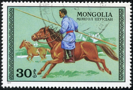 MONGOLIA - CIRCA 1977  A Stamp printed in MONGOLIA shows the image of the Hunter on Horseback, series, circa 1977 Stock Photo - 17472145