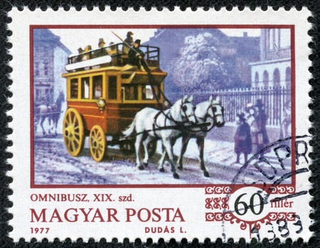 omnibus: HUNGARY - CIRCA 1970  A stamp printed in HUNGARY shows a horse-drawn omnibus  1870 , circa 1977 Stock Photo