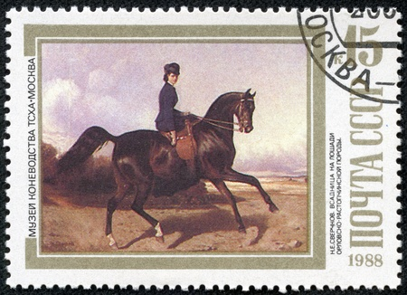 USSR - CIRCA 1988  A stamp printed in USSR shows Horsewoman Riding an Orlov-Rastopchinsky , by N E  Sverchkov, series, circa 1988 Stock Photo - 17436834
