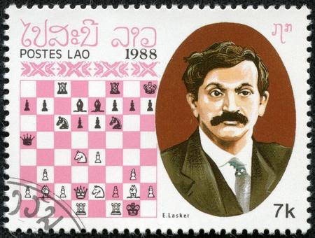 LAOS - CIRCA 1988  A stamp printed in Laos, shows E lasker, Chess Champion, circa 1988 Stock Photo - 17436862