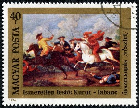 clash: HUNGR�A - CIRCA 1976 Un sello impreso en Hungr�a emitido por el 300o Aniversario del nacimiento del pr�ncipe Ferenc Rakoczi II muestra el enfrentamiento entre Kuruts Rakoczi s and Soldiers Habsburgos, alrededor del a�o 1976 Editorial