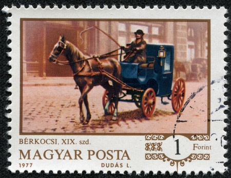 HUNGARY - CIRCA 1977  stamp printed by Hungary, shows One-horse cab at Budapest Railroad Station, circa 1977 Stock Photo - 17436903