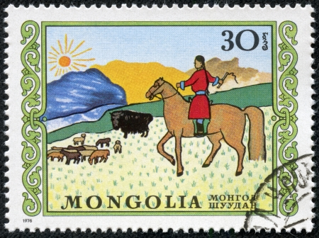 MONGOLIA - CIRCA 1976  A stamp printed in Mongolia shows a woman on horseback herding sheep and yaks on the steppe, child art series, circa 1976