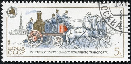USSR - CIRCA 1984  A stamp printed in Russia, shows steam pump, 1904, circa 1984 Stock Photo - 17436894