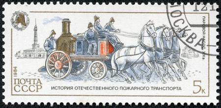 USSR - CIRCA 1984  A stamp printed in Russia, shows steam pump, 1904, circa 1984 Stock Photo - 17436894