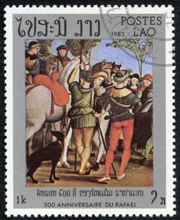 LAOS - CIRCA 1983  A stamp printed in Laos shows draw by Raphael Adoration of the Magi, circa 1983