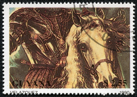 velazquez: GUYANA - CIRCA 1990  a stamp from Guyana shows a Velazquez painting of a horseman in armour, circa 1990