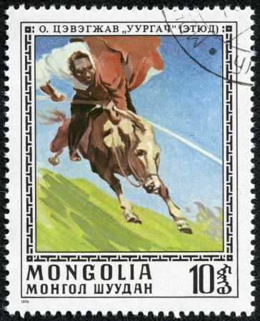 MONGOLIA - CIRCA 1976  A stamp printed in Mongolia showing man riding a horse, circa 1976 Stock Photo - 17554704