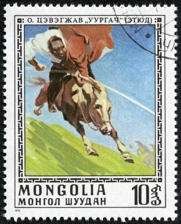 MONGOLIA - CIRCA 1976  A stamp printed in Mongolia showing man riding a horse, circa 1976 Stock Photo - 17554704