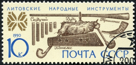 USSR - CIRCA 1990  A stamp printed in USSR shows Lithuanian folk musical instruments, circa 1990 Stock Photo - 17560837