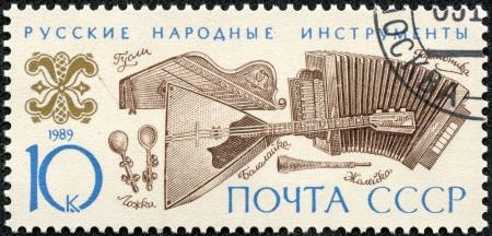USSR - CIRCA 1989  A stamp printed in the USSR shows Russian folk music instruments, circa 1989 Stock Photo - 17560838