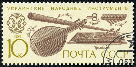 franked: USSR - CIRCA 1989  A stamp printed in the USSR shows Ukrainian folk music instruments, circa 1989 Stock Photo