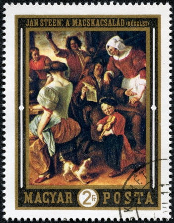 HUNGARY - CIRCA 1969  A stamp printed by Hungary, shows The Feast, by Jan Steen, circa 1969 Stock Photo - 17561544