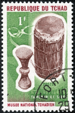 CHAD - CIRCA 1965  stamp printed by Chad, shows Drum and stool, circa 1965 photo
