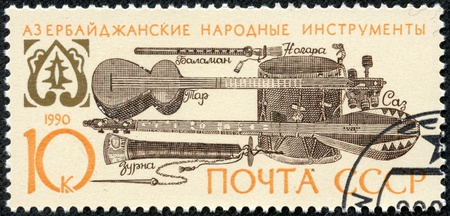 USSR - CIRCA 1990  A stamp printed in USSR shows Azerbaijani folk musical instruments, circa 1990 Stock Photo - 17560835