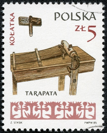 POLAND - CIRCA 1985  A stamp printed in POLAND shows Musical Instruments Door knocker and Tarapata, from series, circa 1985 Stock Photo - 17560725
