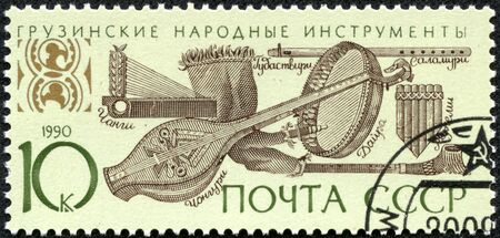 USSR - CIRCA 1990  A stamp printed in the USSR shows Georgian folk music instruments, circa 1990 Stock Photo - 17560842