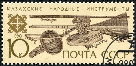 USSR - CIRCA 1990  A stamp printed in USSR shows Kazakh folk musical instruments, circa 1990 Stock Photo - 17560841