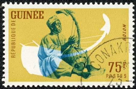 GUINEA CIRCA 1962  A stamp printed by Guinea, shows Musical Instrument, Bolon, circa 1962 Stock Photo - 17560713