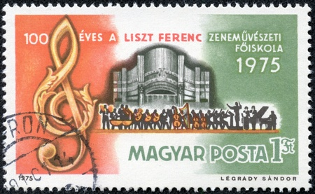 liszt: HUNGARY - CIRCA 1975  A stamp printed in Hungary shows Treble Clef, Organ and Orchestra, honoring Centenary of Ferenc Liszt Music Academy, Budapest, circa 1975 Stock Photo