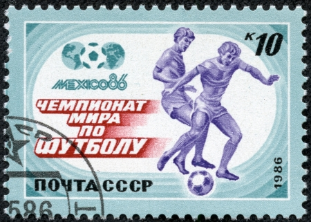 USSR - CIRCA 1986  A stamp printed in USSR, World Cup in Mexico 1986, two players are playing soccer ball football circa 1986 photo